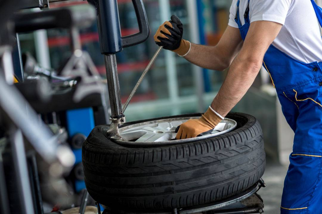 Mechanic removing the wheel tyre