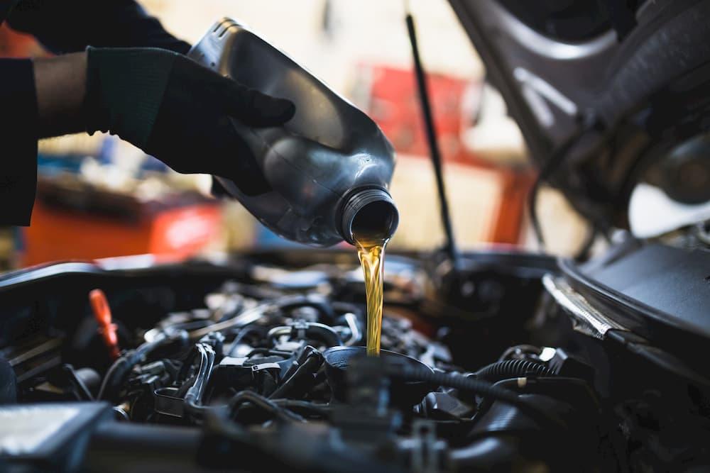 Vehicle maintenance adding oil